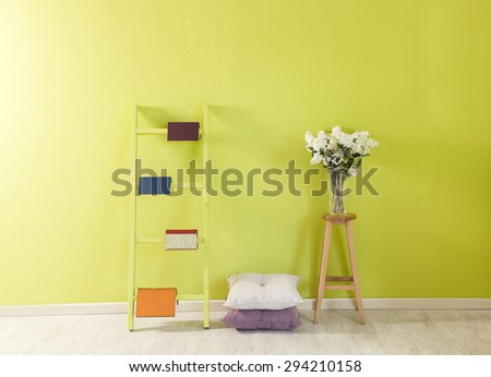 green wall room decor and stairs - stock photo