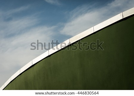 green wall rugby field contrasts with the blue sky - stock photo