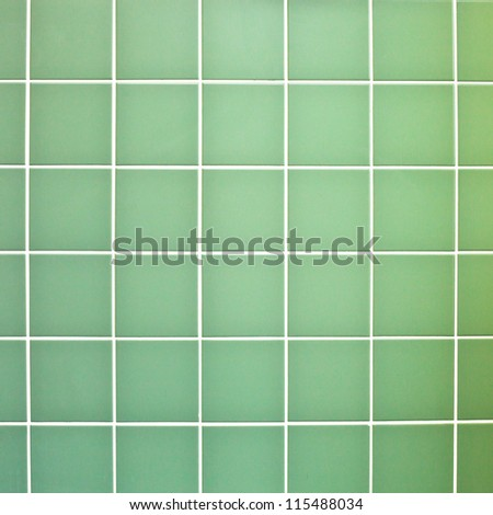 Green wall tiles as a background image - stock photo