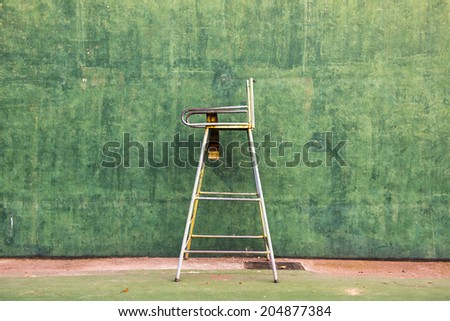 Green walls and seats used in tennis referee - stock photo