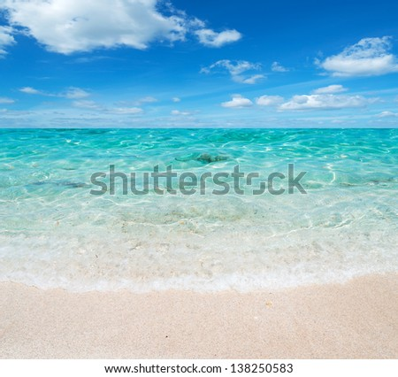green water and blue sky in Sardinia