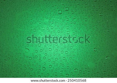 Green water drops background. - stock photo