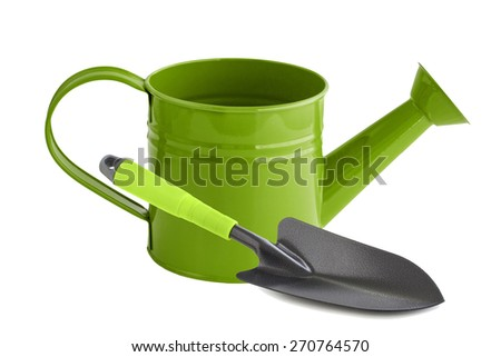 Green watering can and shovel - stock photo