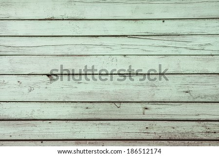 Green weathered wooden door texture - stock photo