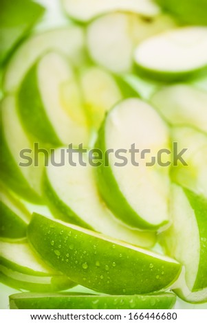 Green wet apple slices. Food background - stock photo