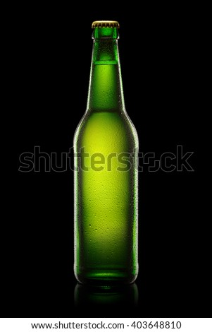 Green wet Bottle of beer isolated on black background. With clipping path. - stock photo