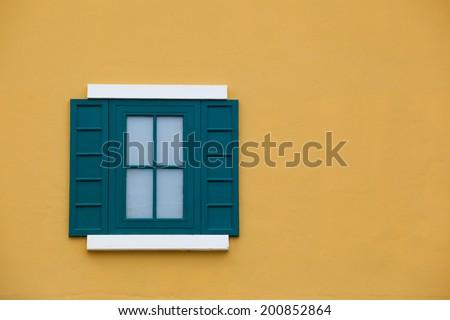Green window on yellow background - stock photo