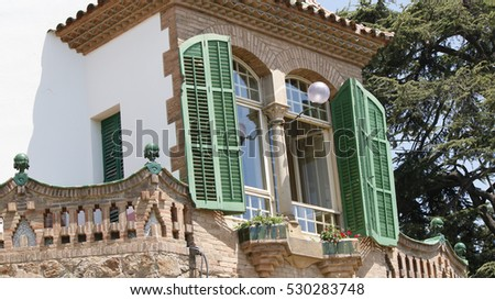 Green window shutters at park Guell, Barcelona, Spain, July 2016