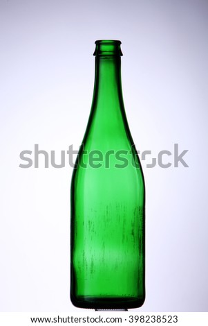 green wine bottle on white background