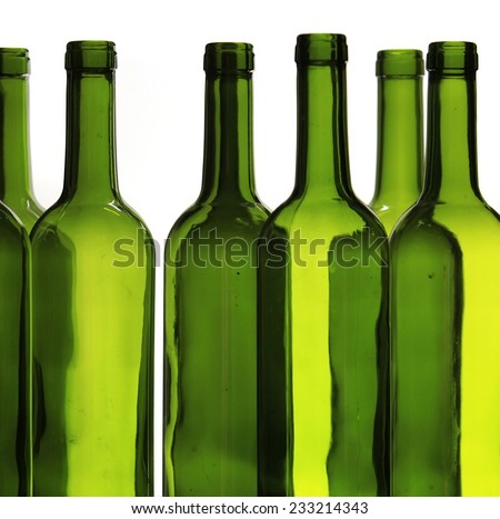 Green wine bottles against white