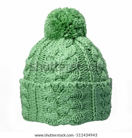 green winter woolen hat, isolated on white