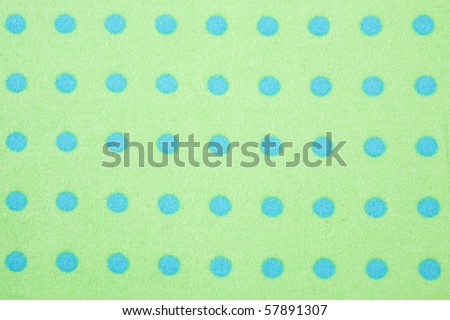 Green with blue polka dots seamless background pattern - stock photo