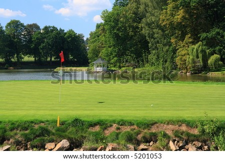 Green with golf hole on an island