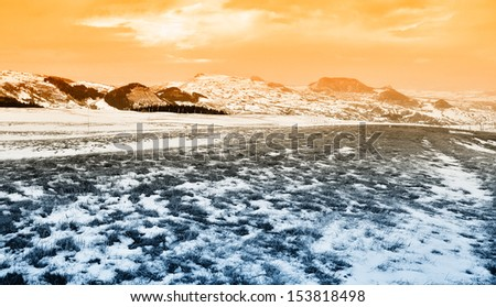 green with snow in mountain at sunset