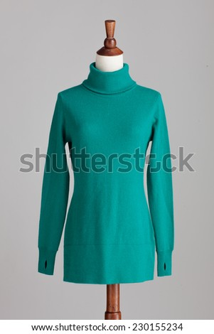 green woman cashmere sweater with wood model on grey isolated - stock photo