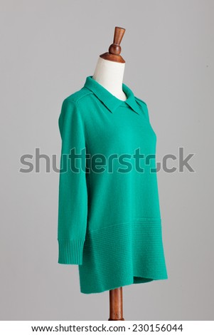 green woman cashmere sweater with wood model on grey isolated