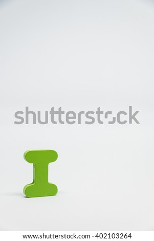 Green Wooden alphabet I with white background in Vertical view - stock photo
