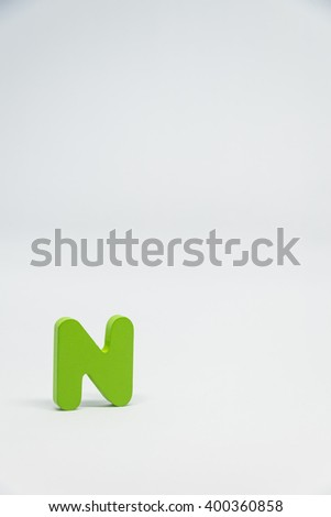 Green Wooden alphabet N with white background in Vertical view - stock photo