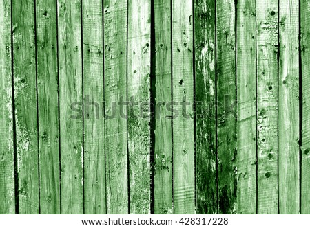 Green wooden fence texture. Background and texture for design. - stock photo