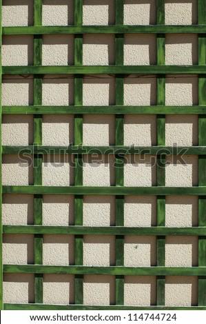 Green wooden lattice wall. - stock photo