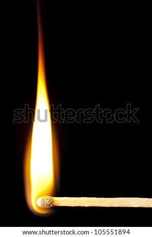 Green Wooden Matches on fire against black - stock photo