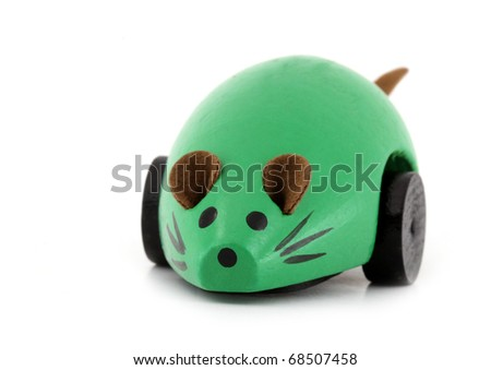 Green wooden mouse with wheels - stock photo