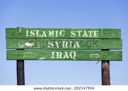 green wooden signpost with arrows showing the directions to Syria, Iraq and the Islamic State. Political concept concerning the war in  Middle East