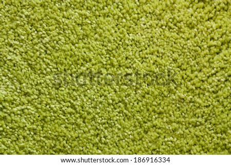 Green wool carpet texture. Abstract background. Macro. - stock photo