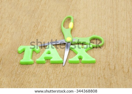 green word tax in fabric background - stock photo