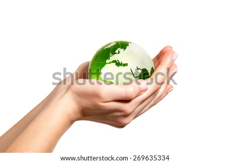 Green world in hand - stock photo