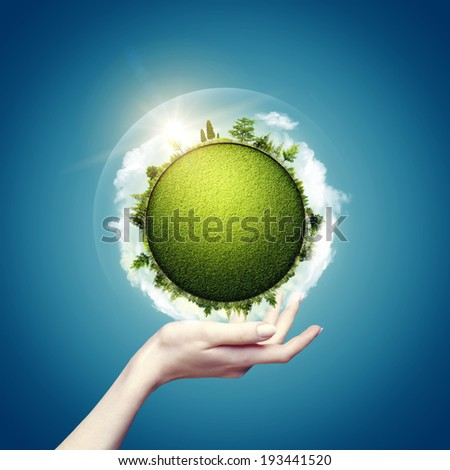 Green world in our hands, abstract eco backgrounds for your design - stock photo