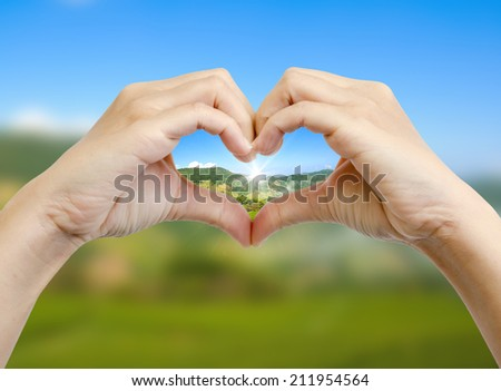 green world in the heart hand concept - stock photo