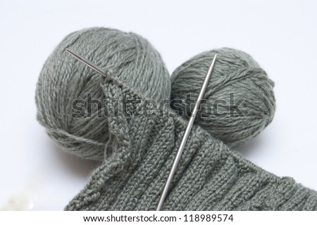 Green yarn for knitting and spokes - stock photo