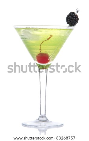 Green yellow alcohol cosmopolitan cocktail decorated with maraschino cherry and blackberry in martini cocktails glass isolated on a white background - stock photo