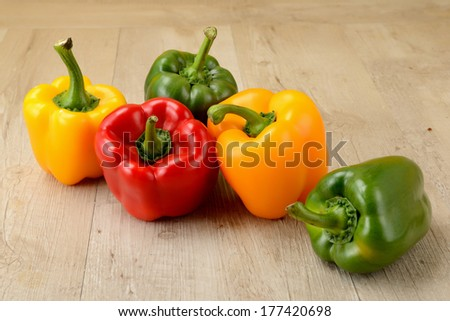 green, yellow and red bell pepper - stock photo