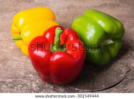 Green , yellow and red bell pepper background - stock photo