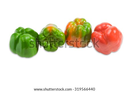 Green, yellow and red fresh bell peppers on a light background. Isolation.