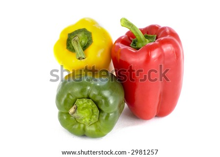 Green , yellow and red pepper on white background
