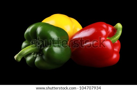 Green Yellow Red Paprika/Peppers isolated on black - stock photo
