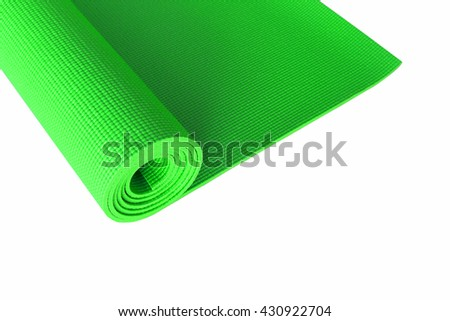 green yoga mat isolated on white.