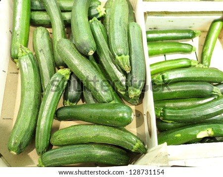 Green zucchini courgette sitting in the supermarket - stock photo