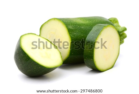green zucchini sliced on white background  - stock photo