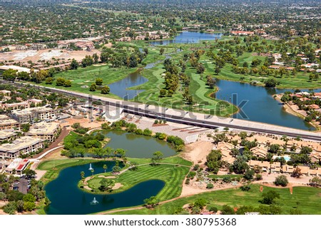 Greenbelt and golf course along the Indian Bend Wash from above in Scottsdale, Arizona - stock photo