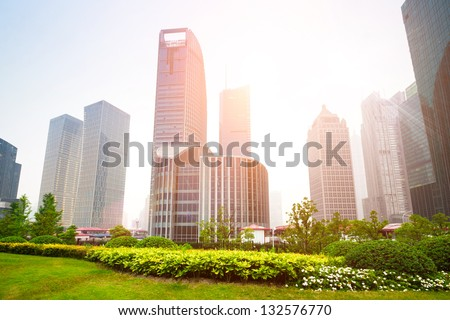 greenbelt park in shanghai financial center district - stock photo