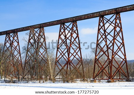 Greene County Indiana's Tulip Viaduct, seen here with winter snow, is a 2,295 foot (700 m) long railroad bridge and is the longest railway trestle in the United States. - stock photo