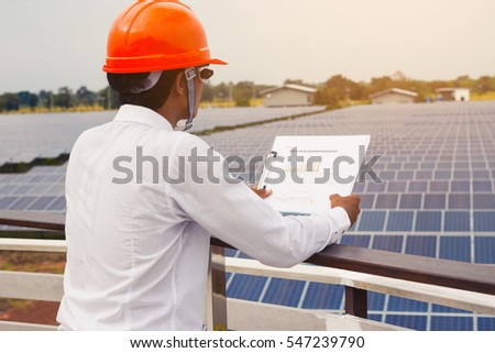 greenergy man working on checking and maintenance equipment at solar power plant;  engineer checking plan for great performance of annual summary