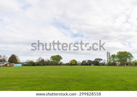 Greenery Field with trees - stock photo