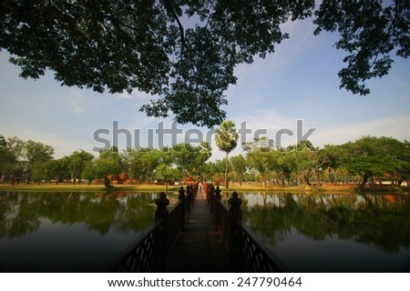 Greenery park and ruins temple of Sukhothai historical park - stock photo