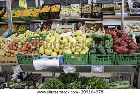 Greengrocer with vegetables and fresh produce, sale - stock photo