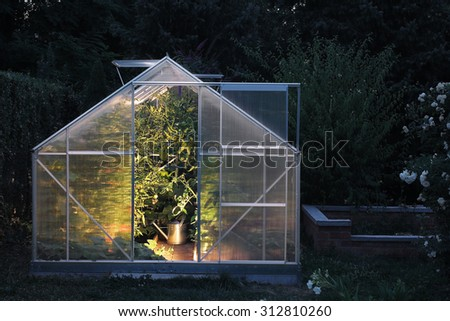 Greenhouse in the night - stock photo